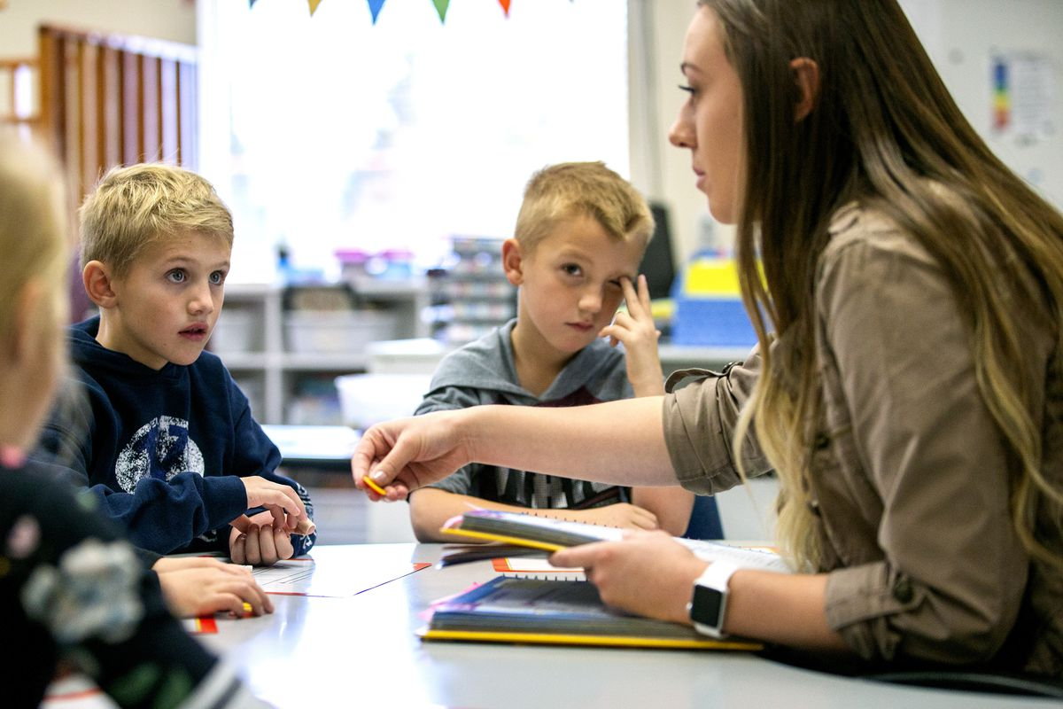Gradee Montague and Mason Slicer listen as head teacher Sierra Westwood gives them instructions as State Superintendent of Public Instruction Sydnee Dickson sits in during a stop at her old elementary school in tiny Antimony, Utah, on Tuesday, Oct. 30, 20