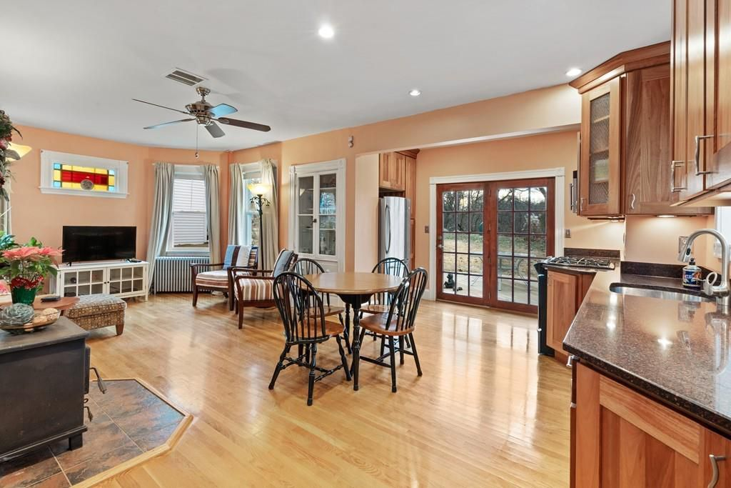 An open dining room-kitchen area with a table and chairs.