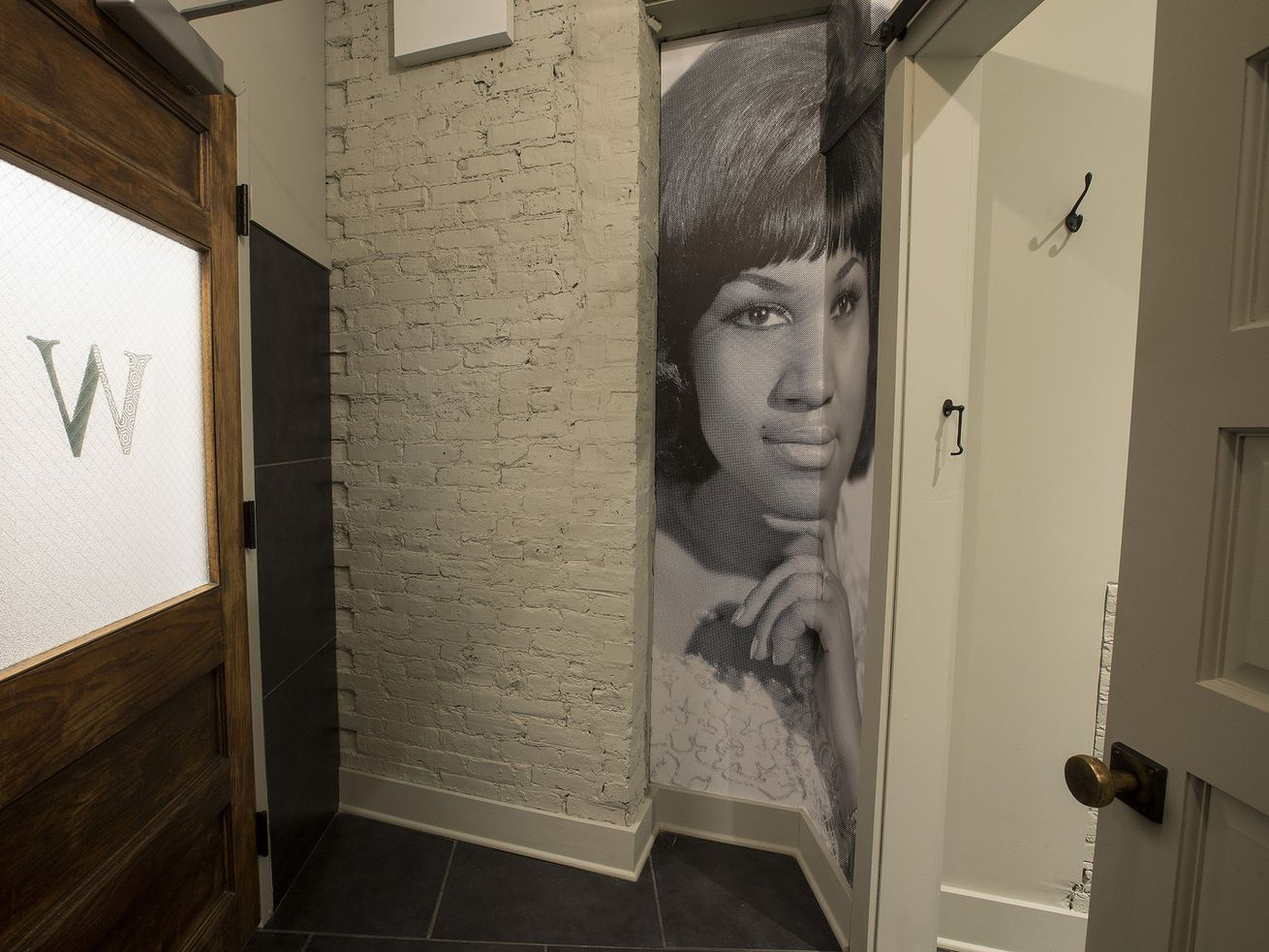 The women's bathroom at Virtue features a tribute to the late Aretha Franklin.