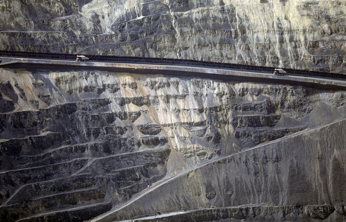 Haul trucks drive through Rio Tinto Kennecott's Bingham Canyon Mine on Friday, April 26, 2019.