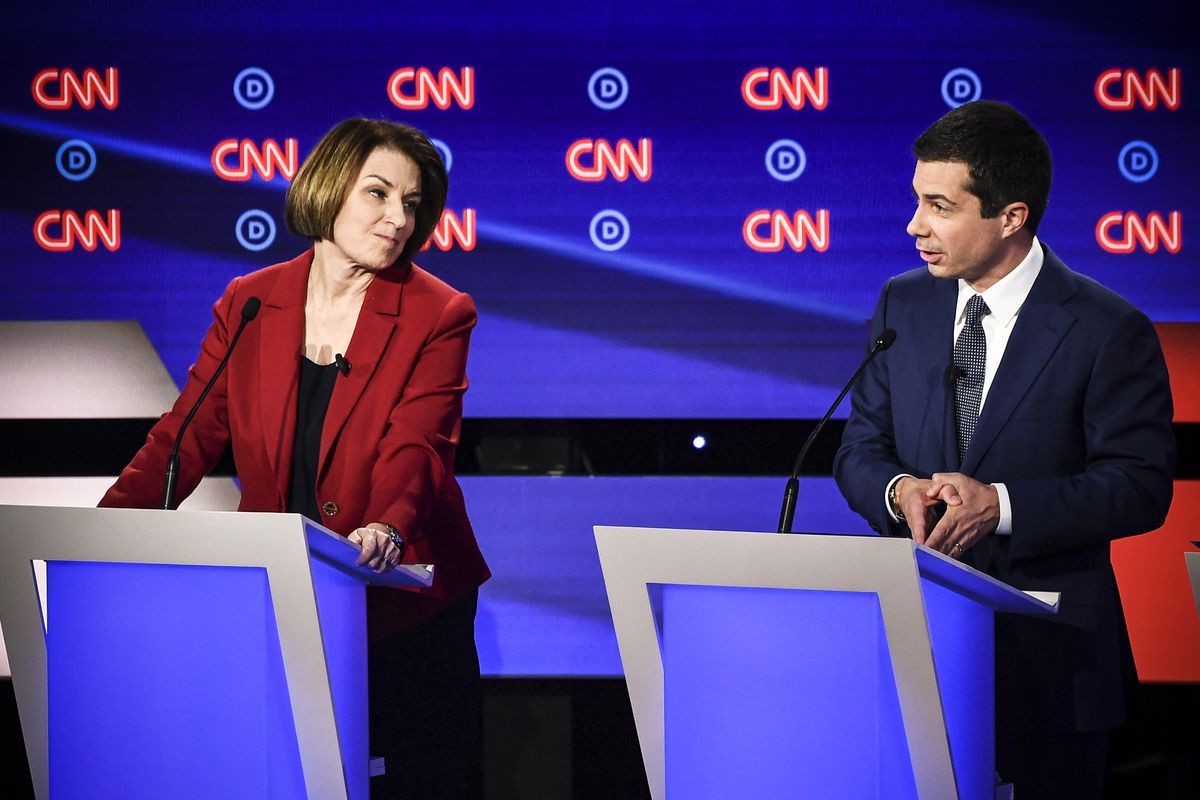 Democratic presidential hopeful Sen. from Minnesota Amy Klobuchar (D-MN) looks on as Mayor of South Bend, Indiana, Pete Buttigieg speaks during the first round of the second Democratic primary debate on July 30, 2019.