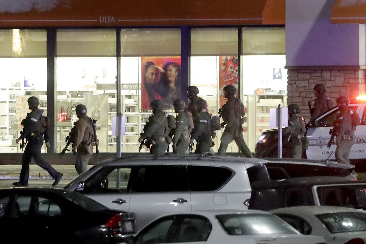 Authorities respond to the Fox River Mall in Grand Chute, Wis., after two people were shot in the mall Sunday, Jan. 31, 2021.