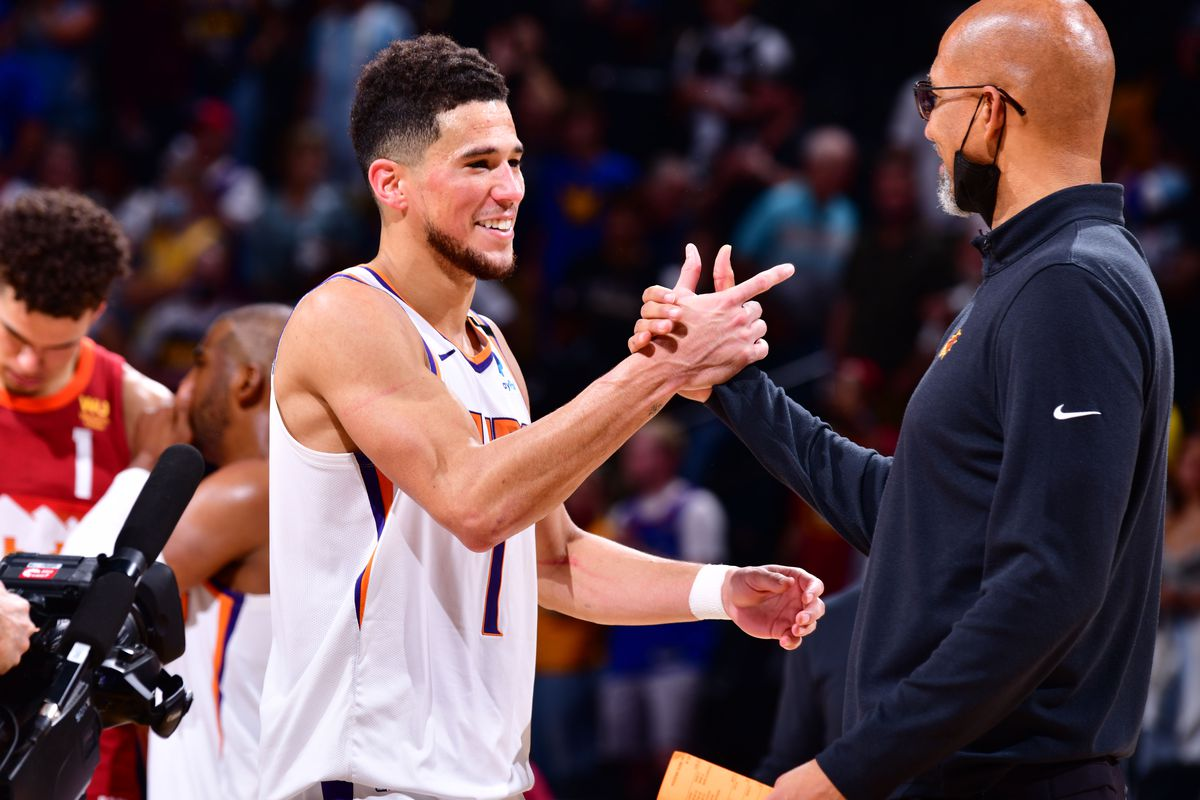 Head Coach Monty Williams of the Phoenix Suns hi-fives Devin Booker of the Phoenix Suns after the game against the Denver Nuggets during Round 2, Game 4 of the 2021 NBA Playoffs on June 13, 2021 at the Ball Arena in Denver, Colorado.