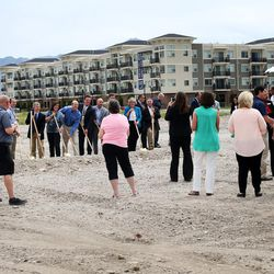 People attend the groundbreaking ceremony for the future Granger Medical Clinic in West Valley City on Wednesday, Aug. 5, 2015.