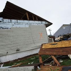 An orange X marks a house unsafe after a tornado struck Washington Terrace on Thursday, Sept. 22, 2016. Officials said nobody was injured in the twister.