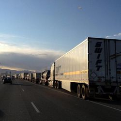 Semitrucks in Centerville are parked along I-15 after multiple trucks were overturned Thursday, Dec. 1, 2011 due to the high winds.