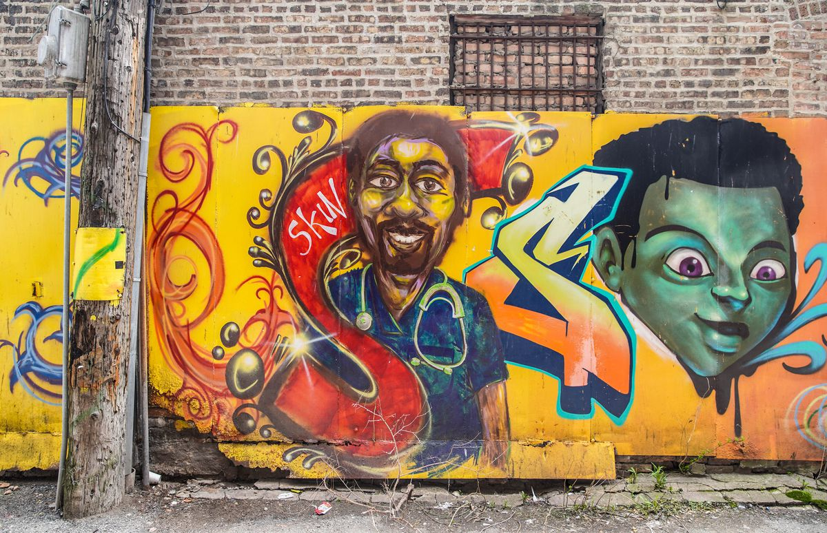 A portion of Paul Branton's mural in the 300 block of East 47th Street.