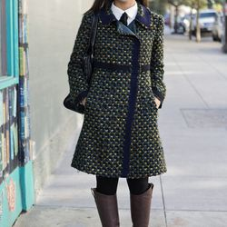 """Maye really nailed the high-low mix, (though most of it is high). She's wearing a Prada tweed coat, Marc Jacobs bag, Karen Walker sunglasses, """"old"""" boots, and a Forever 21 blouse."""
