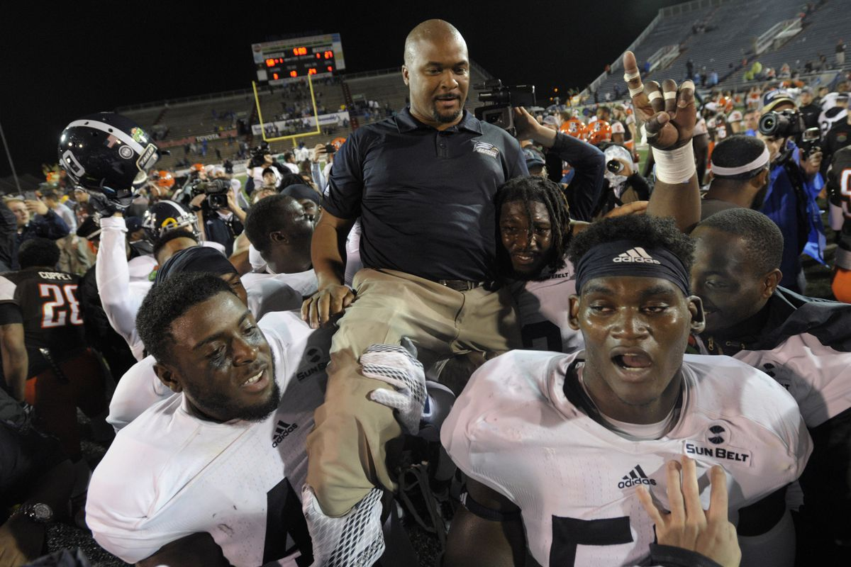 Dell McGee is carried off the field by his players following Georgia Southern's first FBS bowl win, in which he served as the Eagles' head coach.