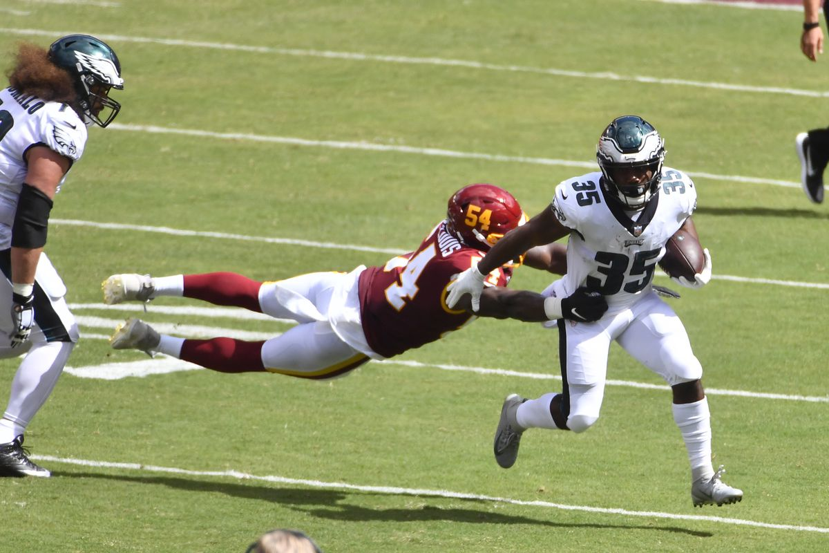 Philadelphia Eagles running back Boston Scott (35) is tackled by Washington Football Team linebacker Kevin Pierre-Louis (54) during the first half quarter at FedExField.
