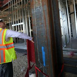 Josh Rohatinsky, project manager, feels the thickness of a steel support beam that ways 26,000 lbs. in the new patient tower of Utah Valley Hospital in Provo on Tuesday, July 5, 2016.
