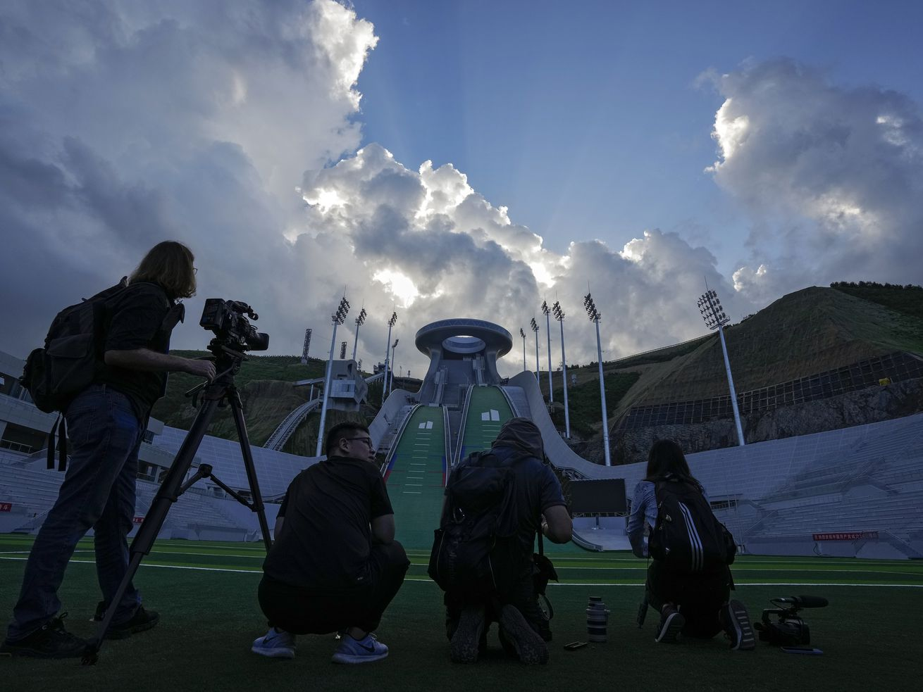 Journalists film the National Ski Jumping Centre, one of the venues for Beijing 2022 Olympic and Paralympic Winter Games.