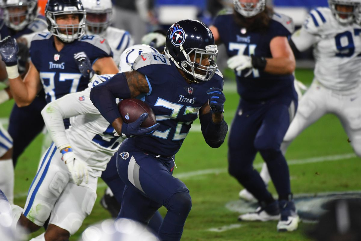Tennessee Titans running back Derrick Henry (22) runs for a first down during the first half against the Indianapolis Colts at Nissan Stadium.