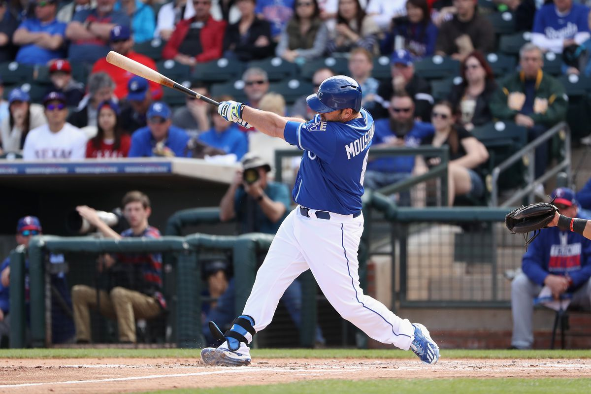 Mike Moustakas bats against the Rangers during Spring training.