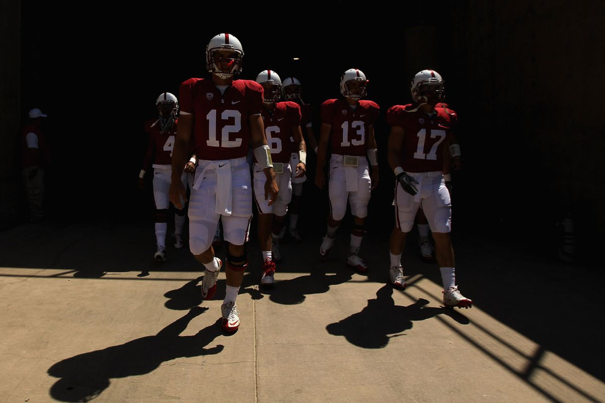 Andrew Luck leads Stanford onto the field for warmups on Saturday.
