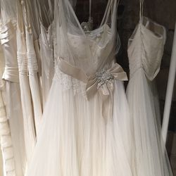 Bridal gown with bow, $1,900