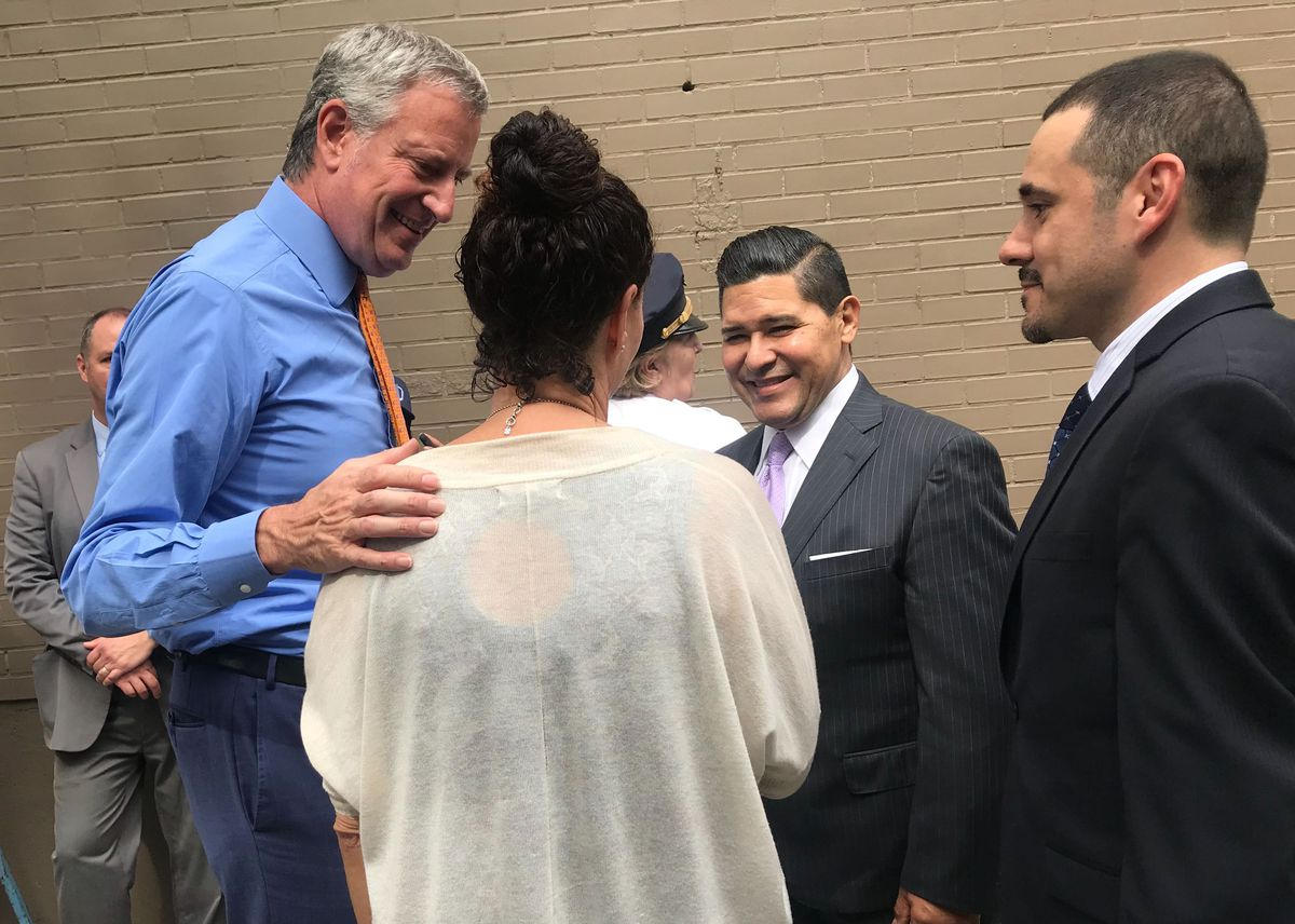 The mayor and the chancellor meet with parents outside P.S. 146.