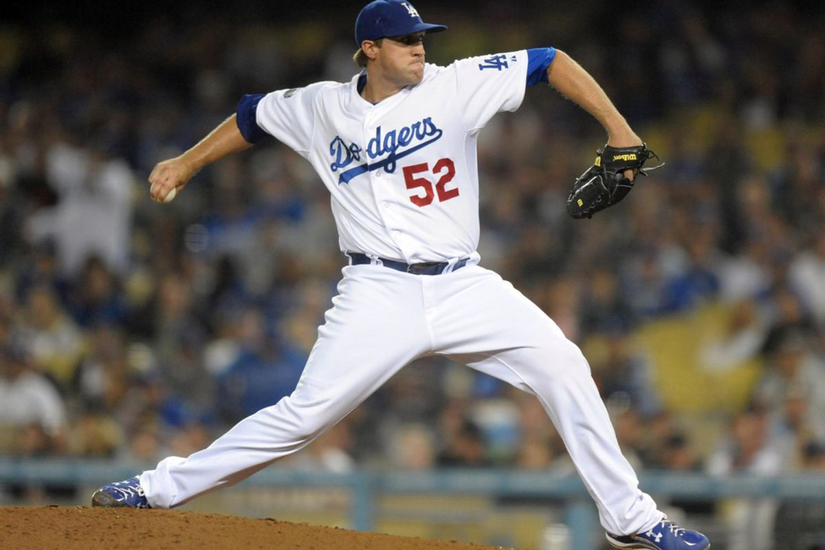 May 7, 2012; Los Angeles, CA, USA; Los Angeles Dodgers reliever Josh Lindbloom (52) delivers a pitch against the San Francisco Giants at Dodger Stadium. The Dodgers defeated the Giants 9-1. Mandatory Credit: Kirby Lee/Image of Sport-US PRESSWIRE