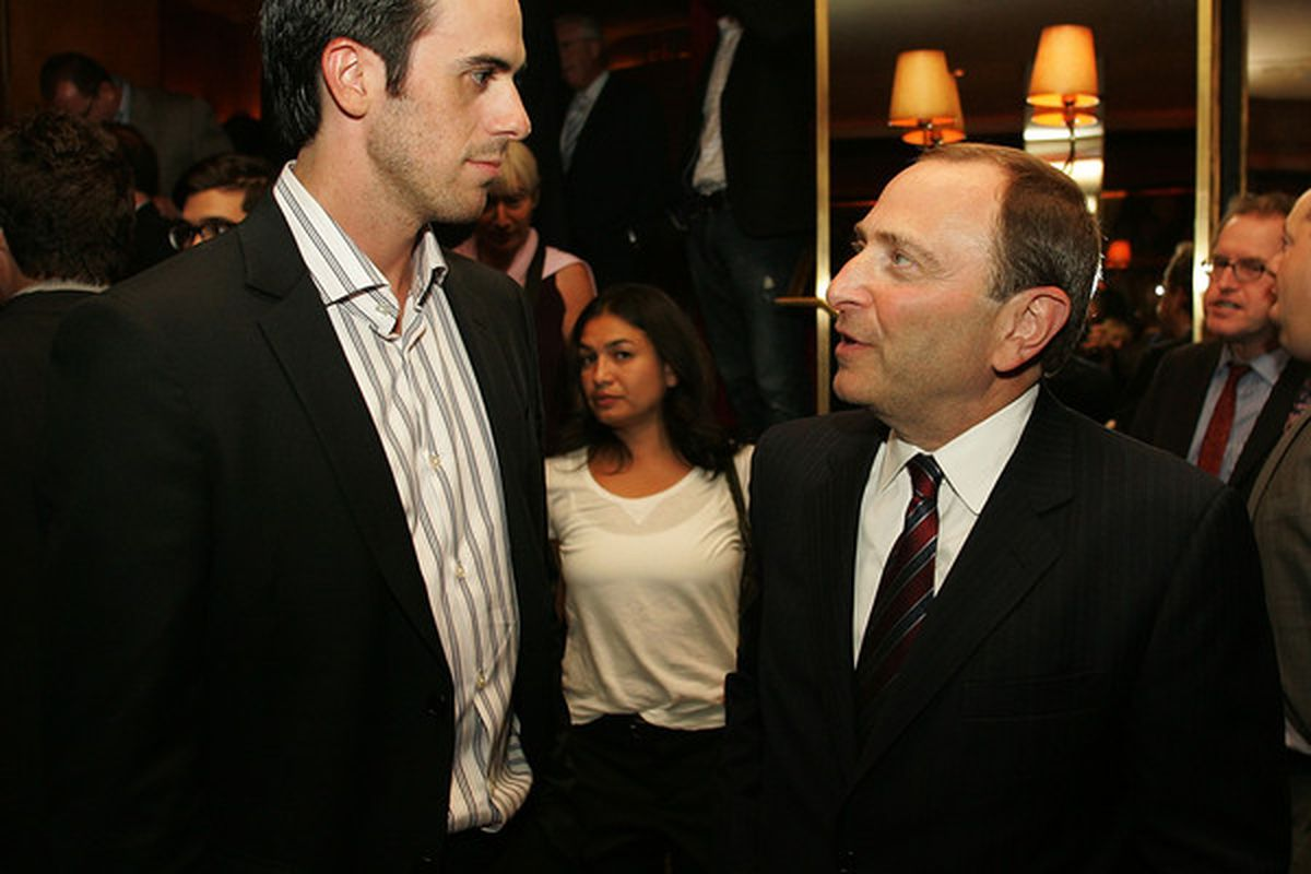 If Ryan Miller is 6'2'', then it looks like Gary Bettman is 4'10''. Andy that woman in the background is 3'8''.