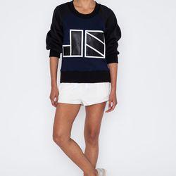 "Jonathan Simkhai Neoprene Sweatshirt, <a href=""https://shopacrimony.com/products/jonathan-simkhai-js-neoprene-sweatshirt"">$604</a>"