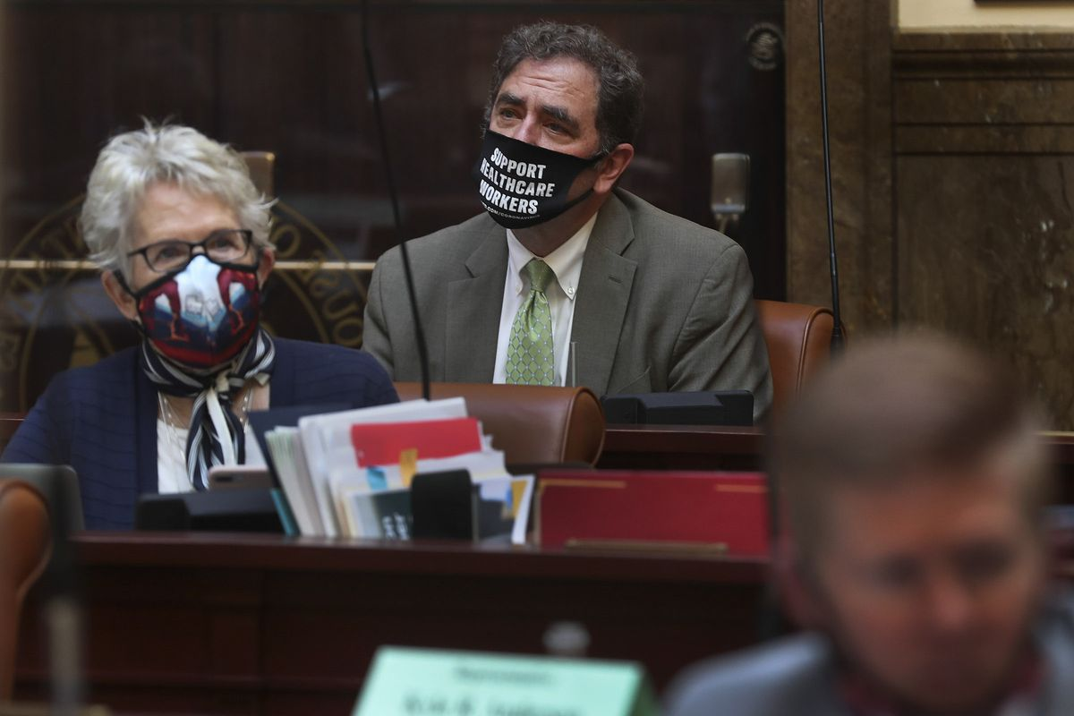 House Minority Leader Brian King, D-Salt Lake City, center, wears a mask as he attends a special session of the Legislature in the House of Representatives to deal with myriad COVID-19 budget changes at the Capitol in Salt Lake City on Thursday, June 18, 2020.