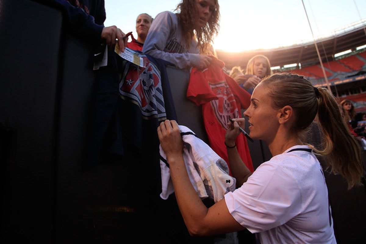CLEVELAND - MAY 22:  Heather Mitts #2 of the United States signs autographs after their win against Germany on May 22, 2010 at Browns Stadium in Cleveland, Ohio.  (Photo by Jared Wickerham/Getty Images)