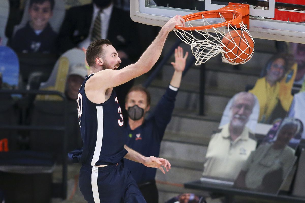 Virginia Cavaliers forward Jay Huff dunks against the Georgia Tech Yellow Jackets in the second half at McCamish Pavilion.