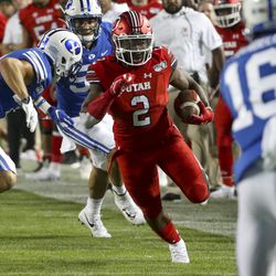 Utah running back Zach Moss (2) heads up during the Utah-BYU football game at LaVell Edwards Stadium in Provo on Thursday, August 29, 2019.