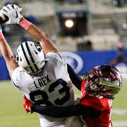 Brigham Young Cougars tight end Isaac Rex (83) catches the ball against Western Kentucky Hilltoppers defensive back Beanie Bishop (29) for a touchdown during an NCAA football game at LaVell Edwards Stadium in Provo on Saturday, Oct. 31, 2020.