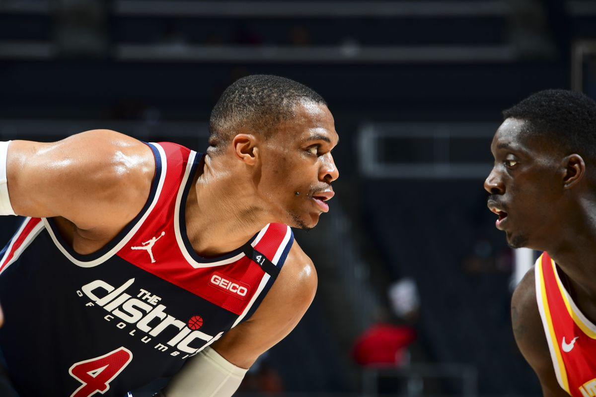 Russell Westbrook of the Washington Wizards handles the ball as Tony Snell of the Atlanta Hawks plays defense during the game on May 12, 2021 at State Farm Arena in Atlanta, Georgia.