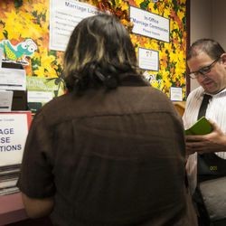 Ariel Ulloa Gonzalez, left, and Gregory Enke fill out paperwork for their marriage certificate at the Salt Lake County Clerk's Office in Salt Lake City, Monday, Oct. 6, 2014.