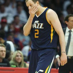 Utah Jazz forward Joe Ingles (2) gets hit in the face during the first round of the NBA playoffs in Los Angeles on Saturday, April 15, 2017.