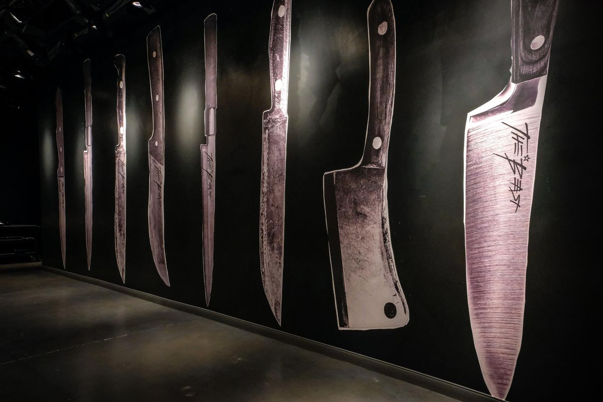 A wall of white knives on a black wall
