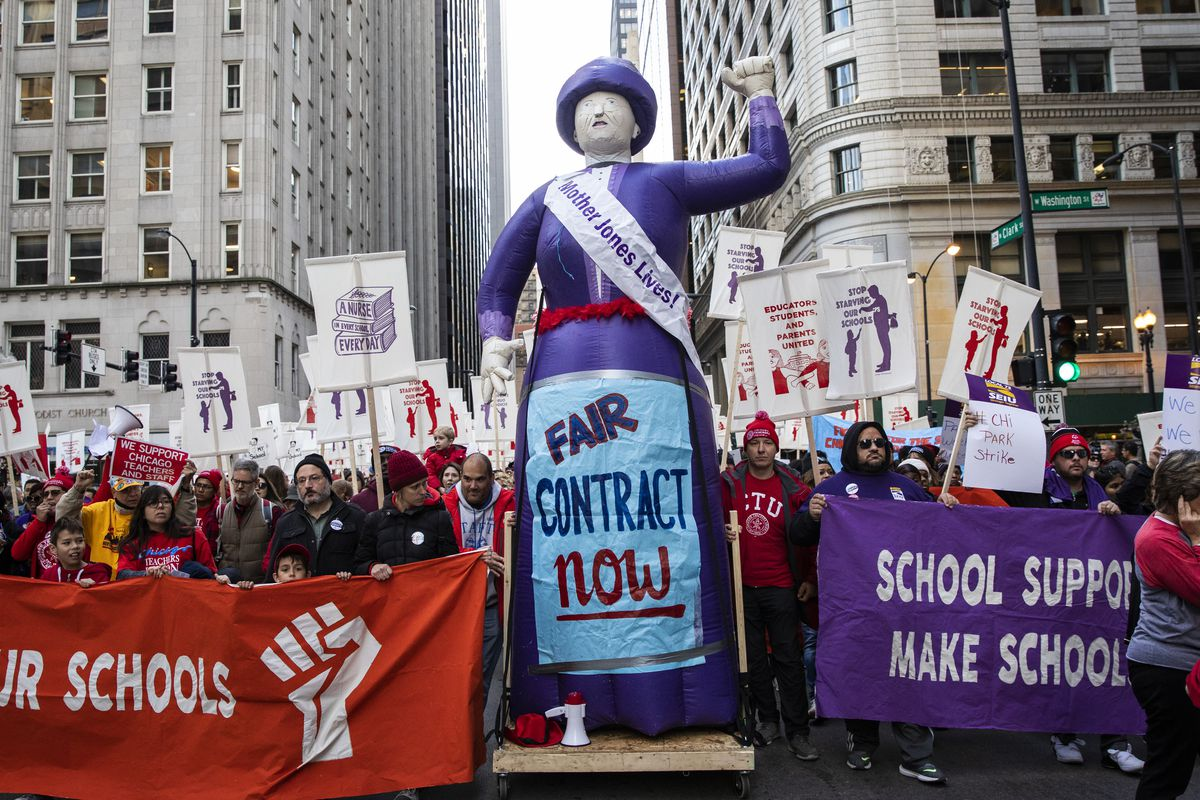 Members of the Chicago Teachers Union and SEIU Local 73 march through the Loop after a rally, three days before the unions could walk off the job on strike, Monday afternoon, Oct. 14, 2019.