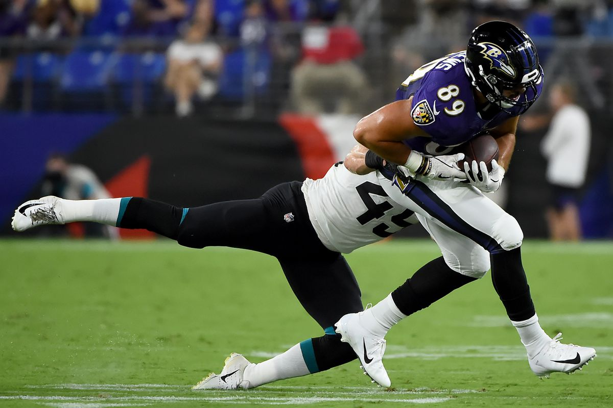 Baltimore Ravens tight end Mark Andrews is tackled by Jacksonville Jaguars linebacker Connor Strachan during the first half of a preseason game at M&T Bank Stadium on August 8, 2019 in Baltimore, Maryland.
