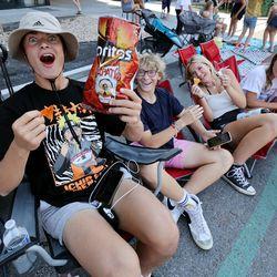 Tommy Lewis, left, Jack Mortensen, Madeline Miller and Keira Lewis enjoy the Days of '47 Parade in Salt Lake City on Friday, July 23, 2021.
