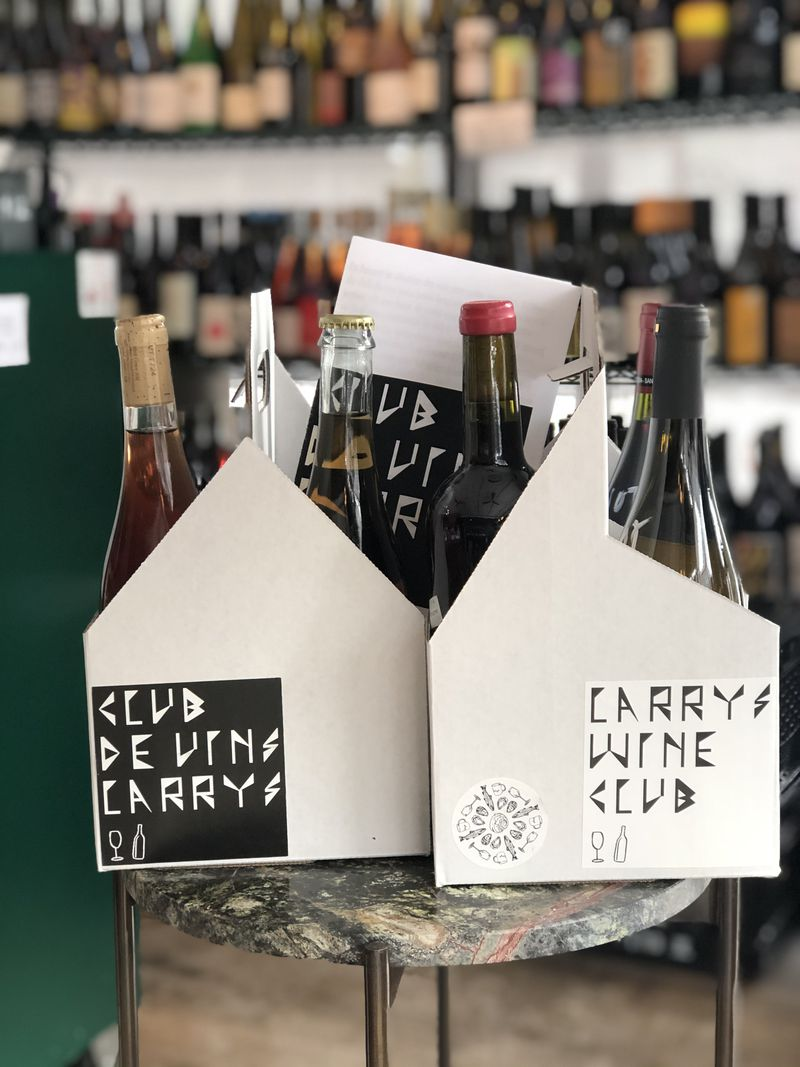 Two cardboard carriers with wine bottles