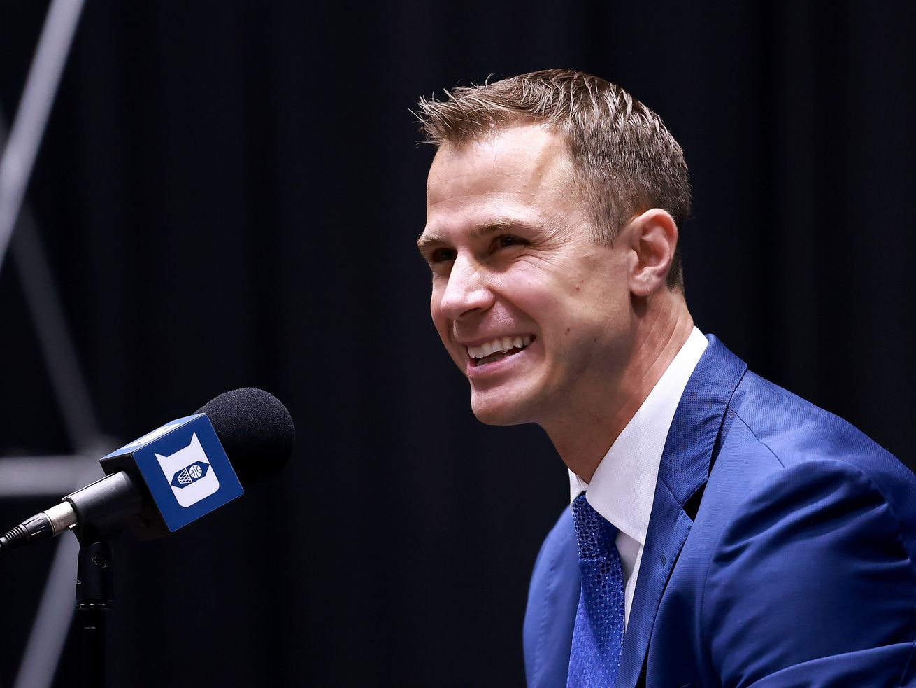 Jon Scheyer speaks after being named the 20th coach of the Duke Blue Devils during a press conference at Cameron Indoor Stadium.