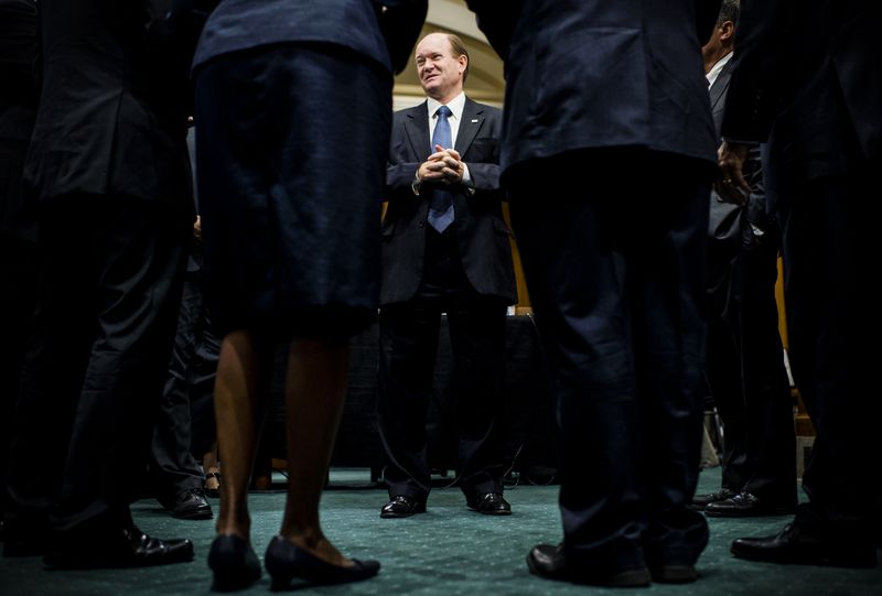 Sen. Chris Coons (D-Del.), talks with nominees up for ambassadorships to African countries, before a Senate Foreign Relations Committee hearing September 24, 2013.