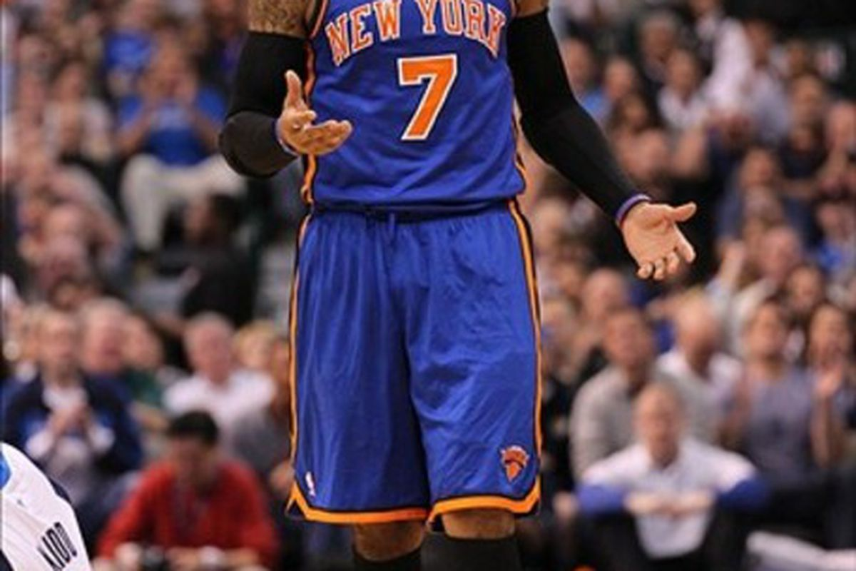 Mar 6, 2012; Dallas, TX, USA; New York Knicks forward Carmelo Anthony (7) reacts to a charging foul call on him during the game against the Dallas Mavericks at American Airlines Center.  Mandatory Credit: Matthew Emmons-US PRESSWIRE