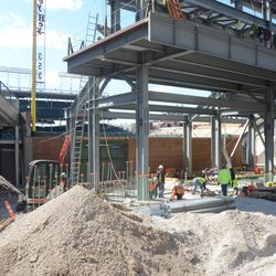 3:10 p.m. Working under the right-field video board structure -