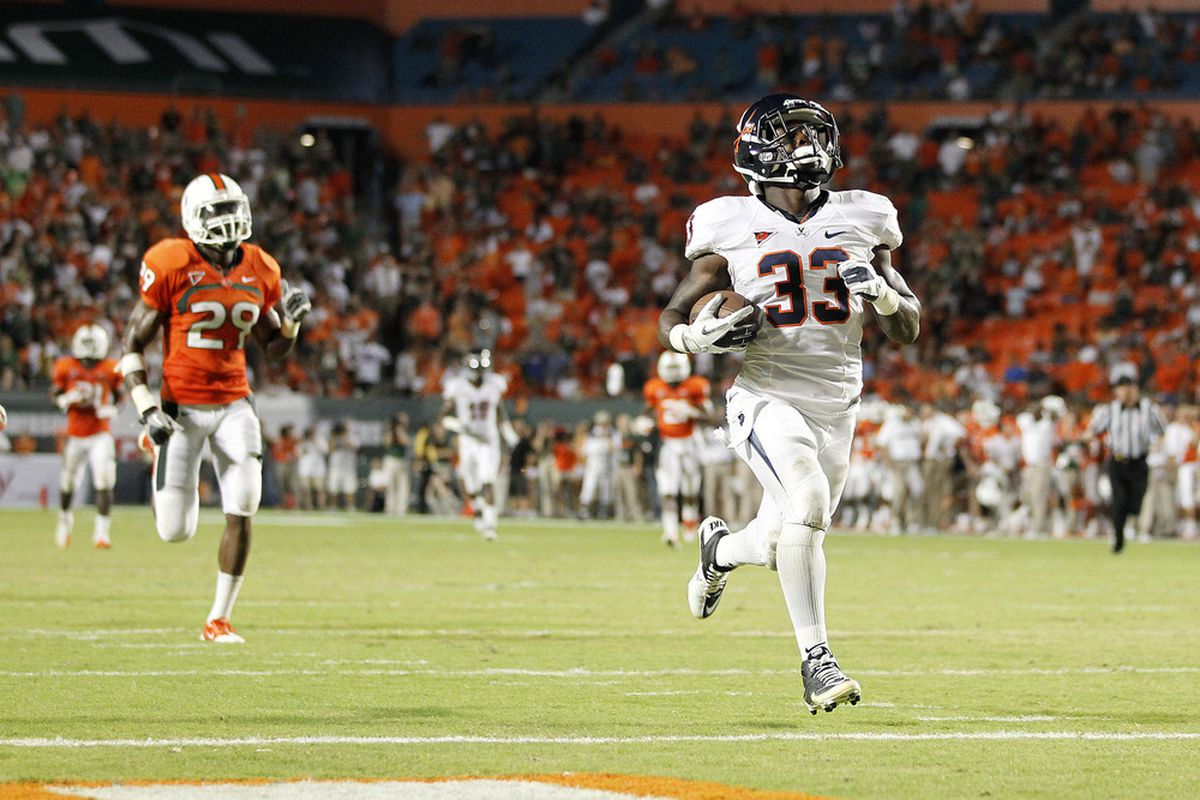 MIAMI, FL - OCTOBER 27: Perry Jones #33 of the Virginia Cavaliers scores the final touchdown against the Miami Hurricanes on October 27, 2011 at Sun Life Stadium in Miami, Florida. Virginia defeated Miami 28-21. (Photo by Joel Auerbach/Getty Images)
