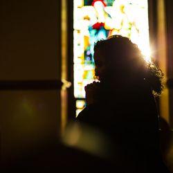 Raisa Carrasco-Velez, director of Multicultural Affairs & Community Development at St. John's Preparatory School, poses for a portrait in the school's chapel in Danvers, Massachusetts on March 13, 2017.