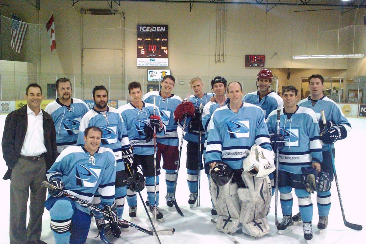 Doan poses for a team photo with Sky Blues after their 6-4 win over the Coyotes