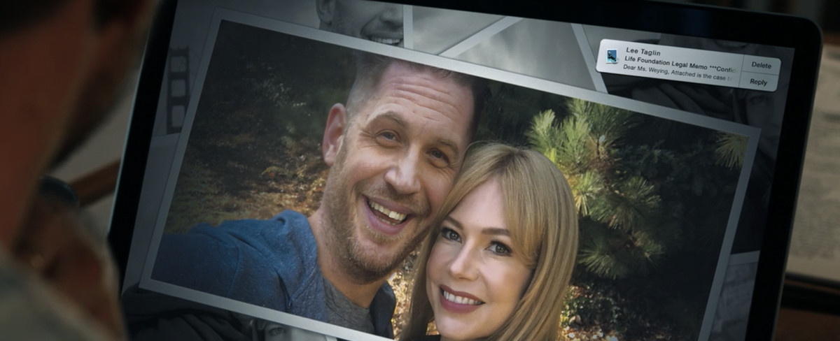 A photograph of Eddie and Anne together in the woods. Tom Hardy wears an expression of pure mirth next to his blonde girlfriend.