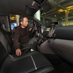 Nissan Model Relations Manager Kengo Yoneda tests the instrument panel in the driver's compartment of the prototype of a Nissan NV 200 New York City taxi, in New York, Monday, April 2, 2012. The iconic New York City taxi has gotten a passenger-friendly makeover from Nissan with low-annoyance horns, USB chargers and germ-fighting seats to cut down on bad odors. Medallion owners will be required to buy the Nissan NV 200 at a cost of about $29,000 starting in late 2013.