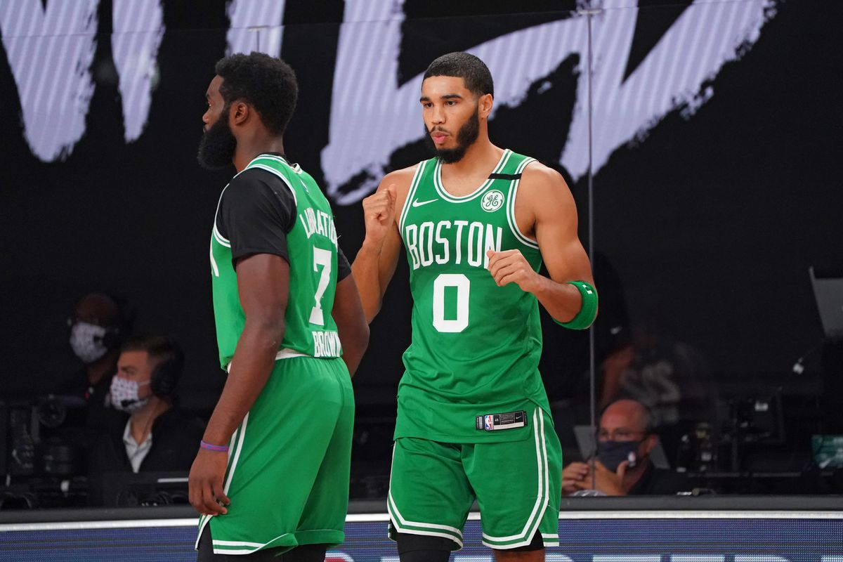 Jaylen Brown of the Boston Celtics and Jayson Tatum #0 of the Boston Celtics high-five prior to a game against the Miami Heat during Game Four of the Eastern Conference Finals of the NBA Playoffs on September 23, 2020 at the AdventHealth Arena at ESPN Wide World Of Sports Complex in Orlando, Florida.