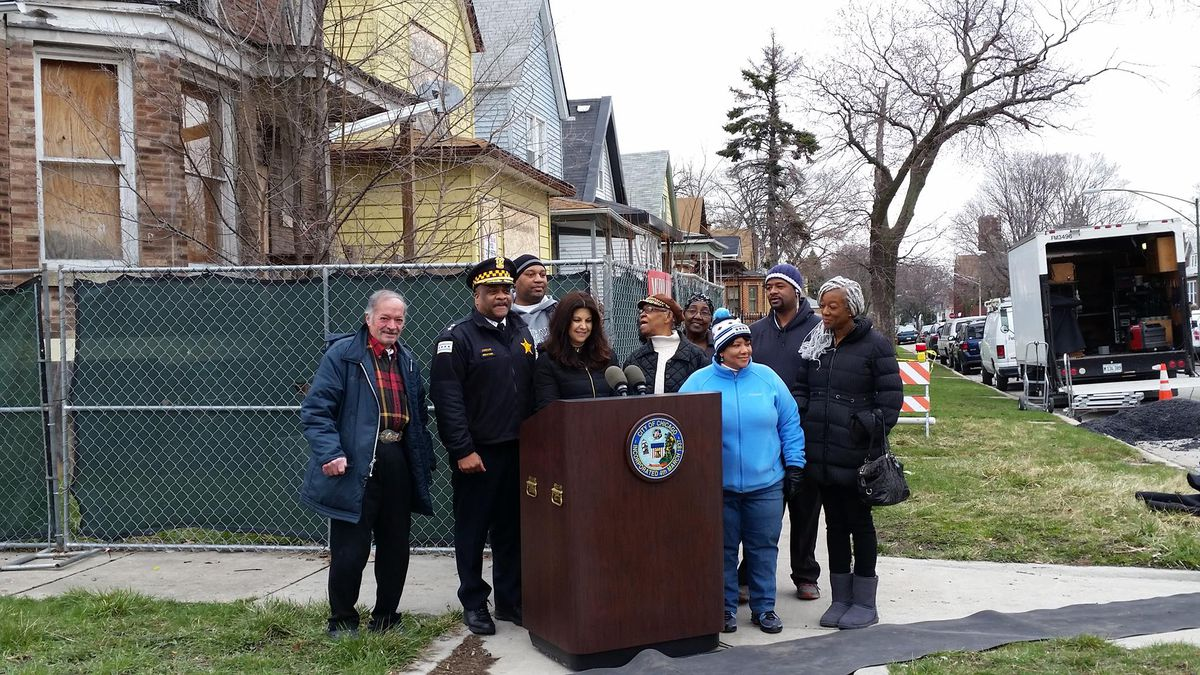 Chief of Patrol Eddie Johnson, second from left, with Buildings Commissioner Judy Frydland, Ald. Toni Foulkes (16th) and community members at a recent news conference on the South Side to announce the demolition of an abandoned building in a high-crime ar