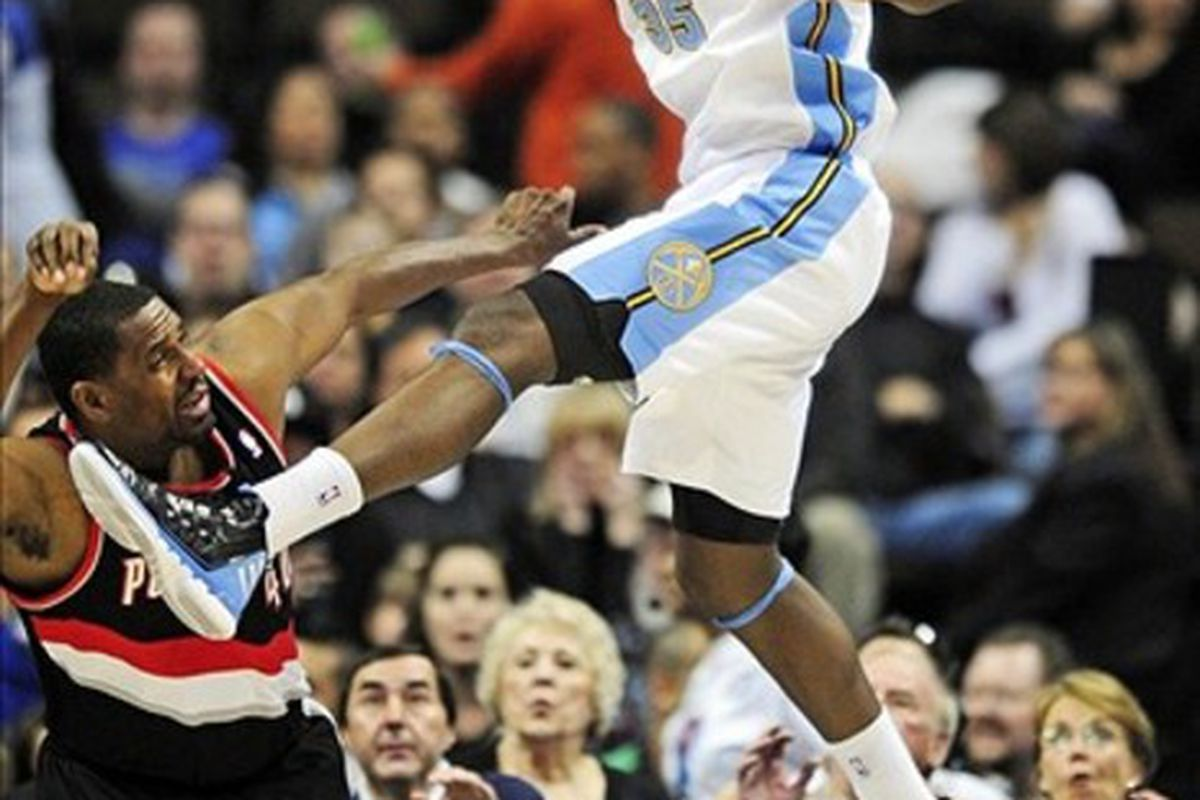 Kenneth Faried with accidental kick on Kurt Thomas. Faried was all over the place for the Nuggets.