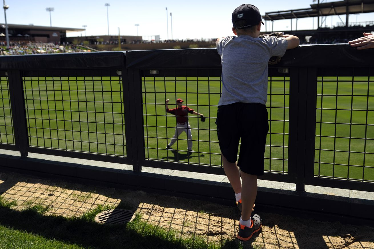 John-Chael Holyk, 9, watches warms before a game between the Colorado Rockies and the Arizona Diamondbacks during the first game of Spring Training at Salt River Fields at Talking Stick in Scottsdale, Arizona on Saturday, March 3, 2012. AAron Ontiveroz, T